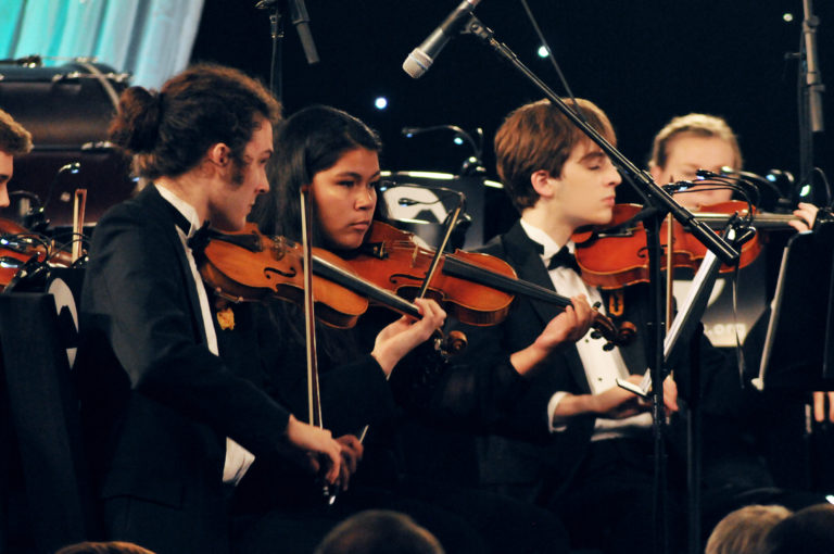 "Oklahoma Arts Institute Orchestra members perform ""The Magnificent Seven."""