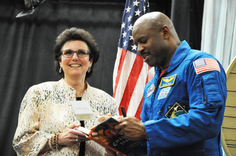 "Keynote speaker Leland Melvin signs his book ""Chasing Space"" for Oklahoma Teacher of the Year Donna Gradel , a 2014 Medal for Excellence winner from Broken Arrow. The All-Staters and Medal for Excellence winners all received autographed copies of Melvin's book as a gift from foundation trustees."