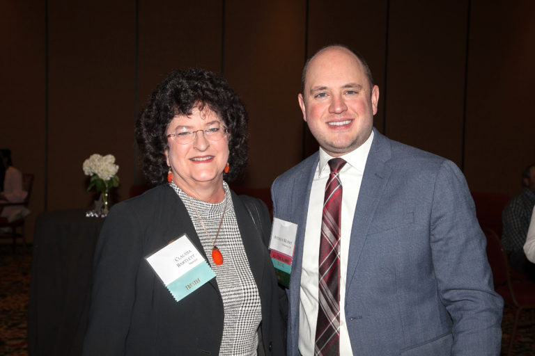 Trustee and Teacher Grant supporter Claudia Bartlett of Sapulpa visits with 2004 All-State Alumnus Andrew Morris, a fellow trustee and member of the banquet committee.
