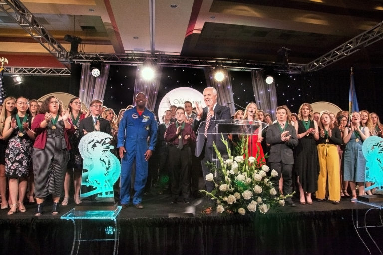Astronaut Leland Melvin joins Academic All-Staters on stage for the banquet grand finale.