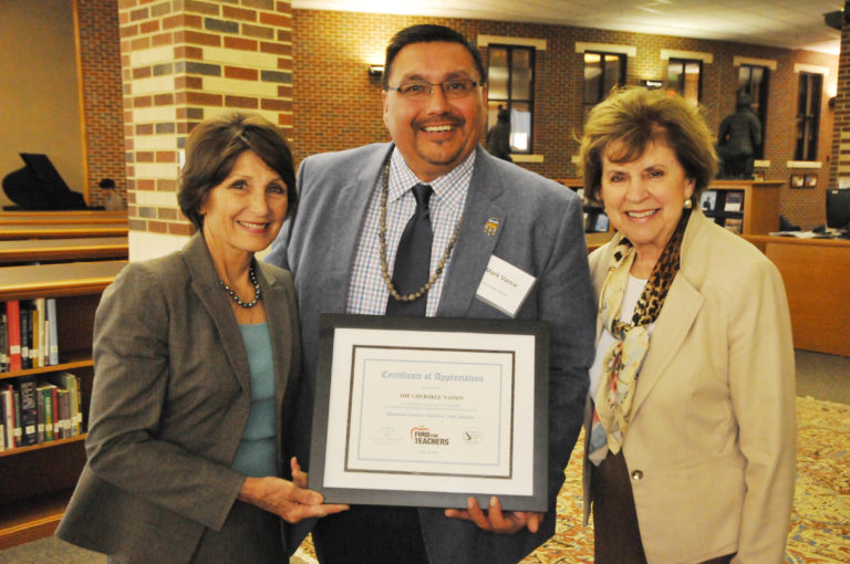 Oklahoma Foundation for Excellence President Cathy Render (left) and Executive Director Emily Stratton (right) present a certificate to Mark Vance of the Cherokee Nation recognizing his tribe's support of the 2019 Fund for Teachers Program.