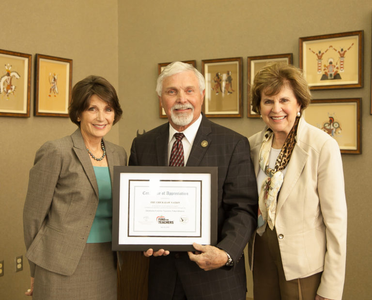 Oklahoma Foundation for Excellence President Cathy Render (left) and Executive Director Emily Stratton (right) present a certificate to Danny Wells of the Chickasaw Nation recognizing his tribe's generous support of the 2019 Oklahoma Fund for Teachers Program.
