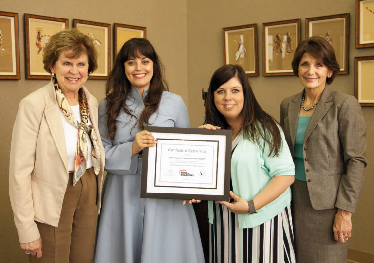 Oklahoma Foundation for Excellence Executive Director Emily Stratton (left) and President Cathy Render (right) present a certificate of appreciation to Citizen Potawatomie Nation representatives Tesia Zientek (second from left) and Stephanie Hawk (third from left) for their tribe's support of the 2019 Oklahoma Fund for Teachers Program.