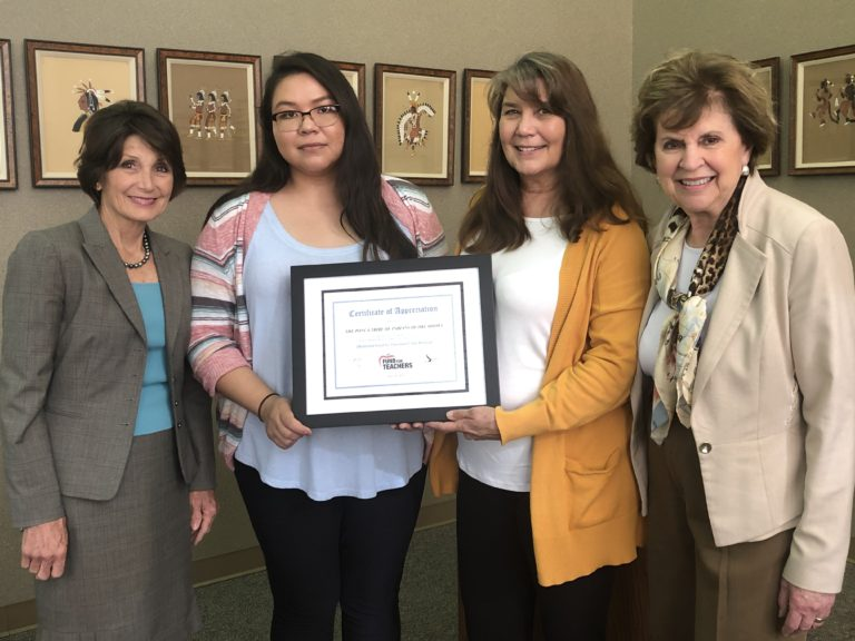 Oklahoma Foundation for Excellence President Cathy Render (left) and Executive Director Emily Stratton (right) present a certificate to Reagan Cole (second from left) and Sarah Allen-Nelson of the Ponca Tribe of Indians of Oklahoma recognizing their tribe's support of the 2019 Oklahoma Fund for Teachers Program.